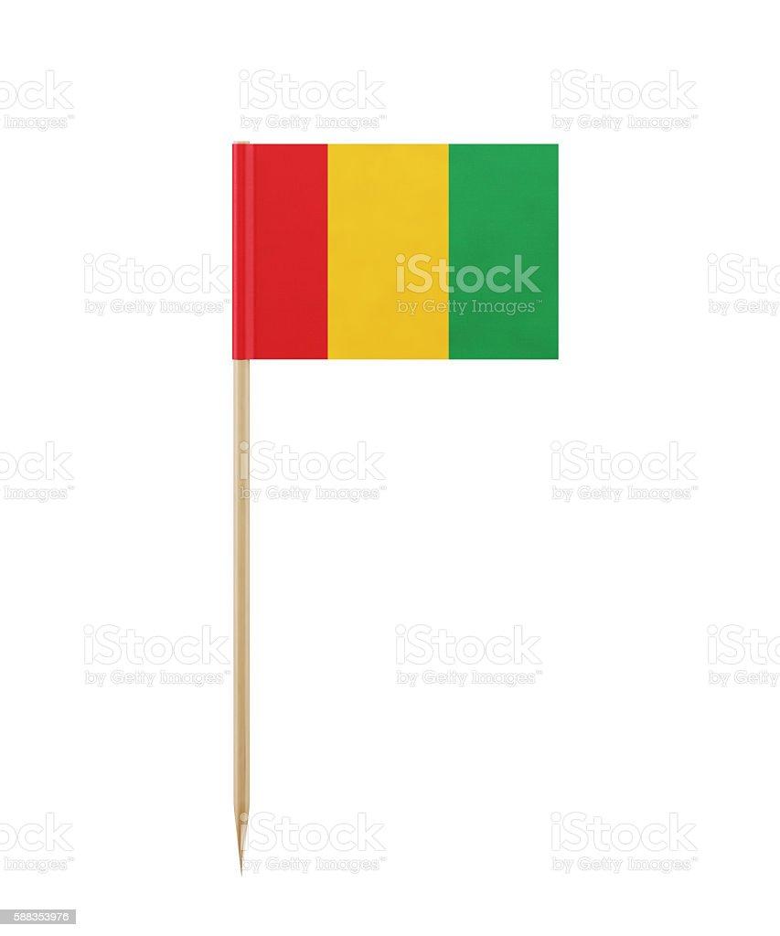 Tiny Guinea Flag on a Toothpick stock photo
