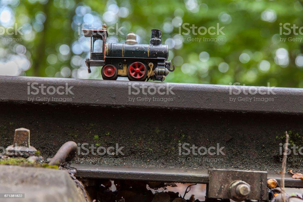 Tiny metal toy locomotive stock photo