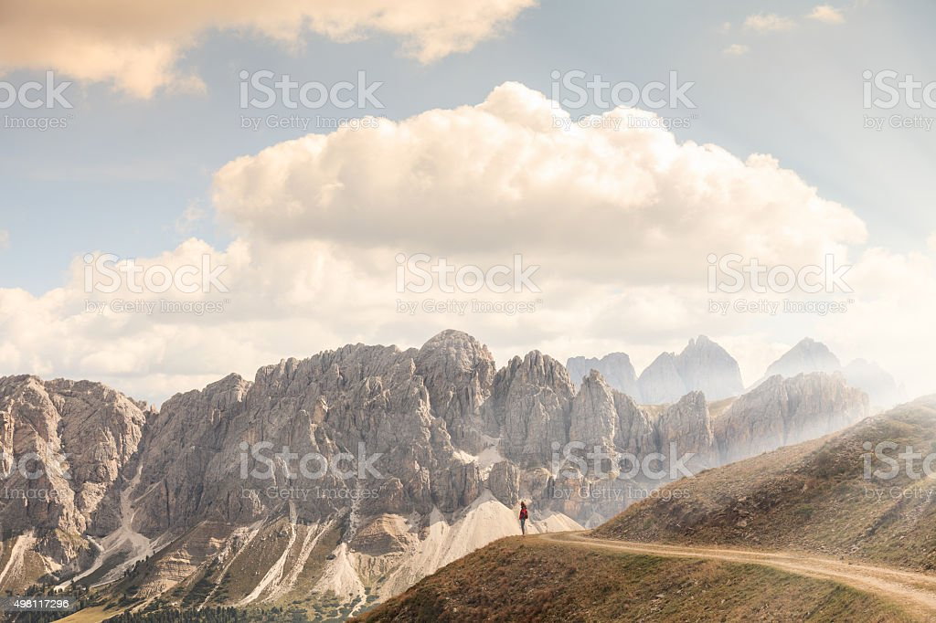 Tiny person admiring nature greatness in the mountains stock photo