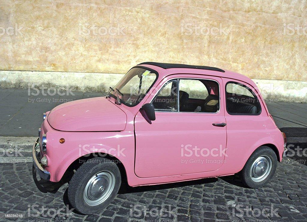Tiny pink vintage car, Rome Italy royalty-free stock photo