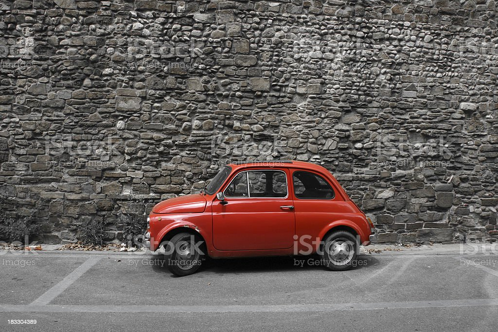 Tiny red vintage car in Florence, Italy stock photo