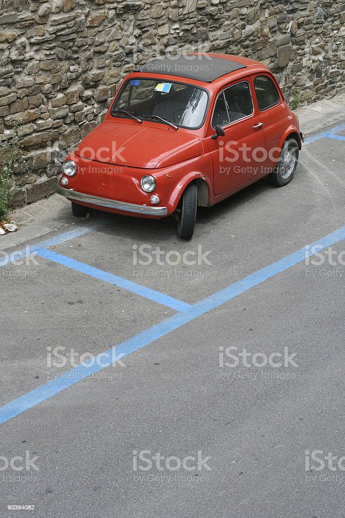 Tiny red vintage car in Florence royalty-free stock photo