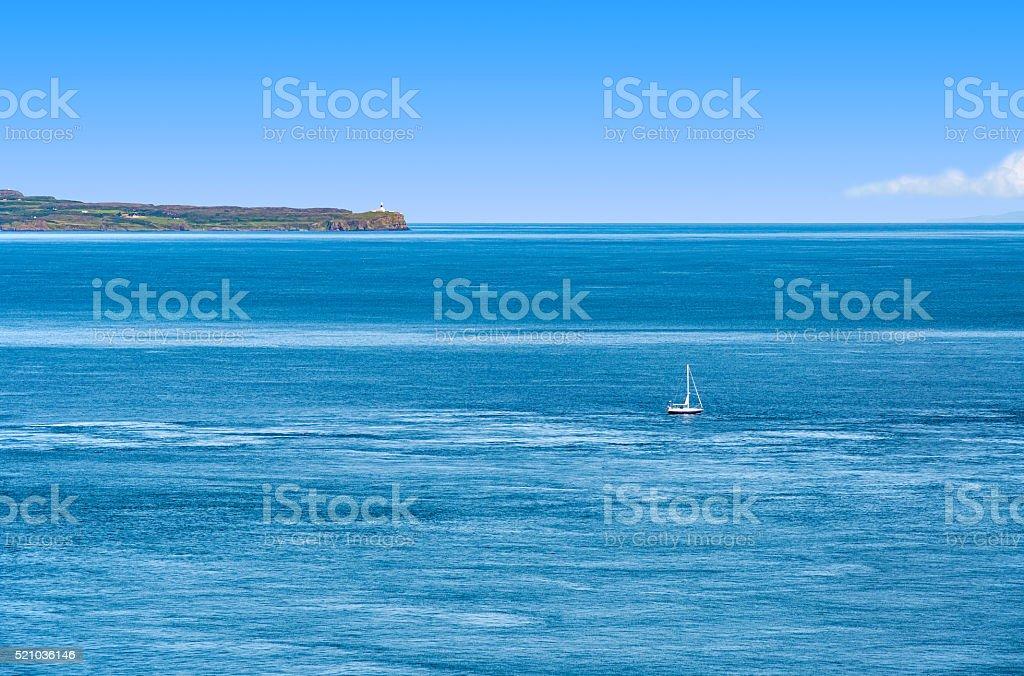 Tiny sailboat on the Atlantic stock photo