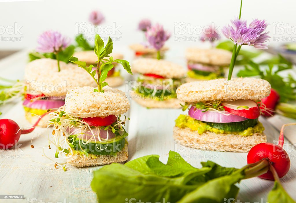 Tiny Tea Sandwiches With Chive Flowers & Sprouts stock photo
