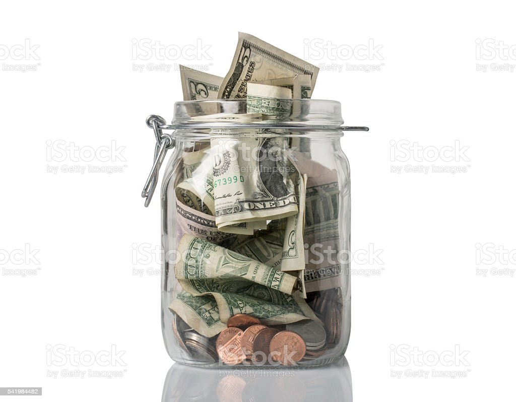 Tip Jar Overflowing stock photo