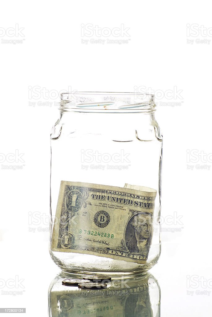 A tip jar with a dollar bill inside royalty-free stock photo