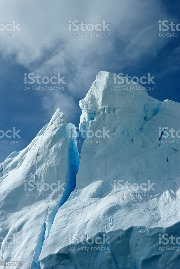 Tip of an iceberg against a blue sky Antarctic summer. stock photo