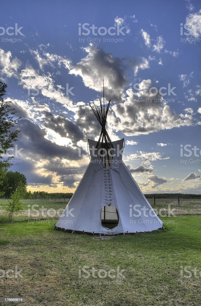 tipi in the sunset of rocky mountain house Alberta royalty-free stock photo