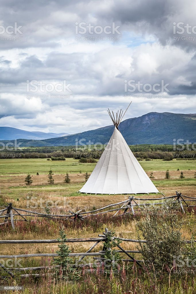 Tipi with storm clouds stock photo