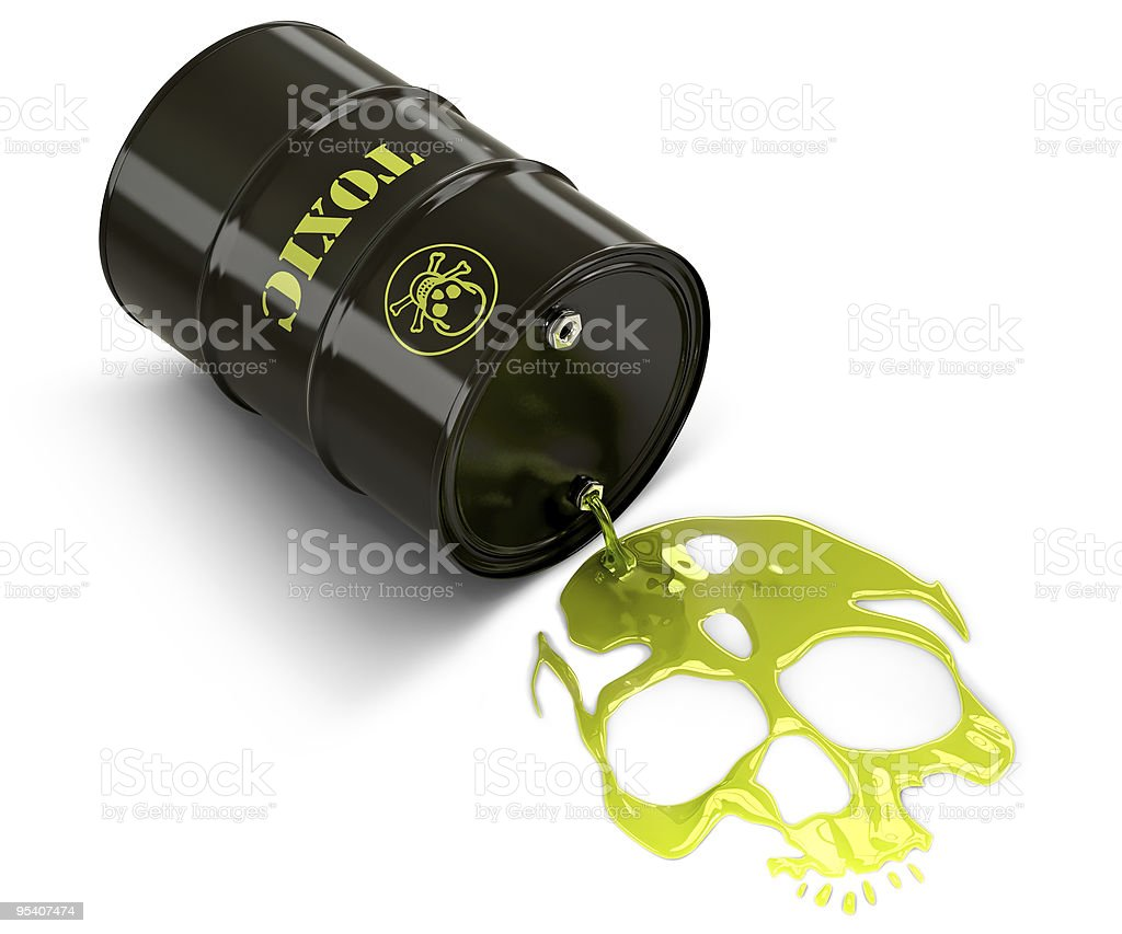 A tipped black barrel with green toxic waste spilling out stock photo