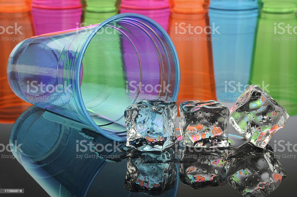 Tipped Blue Drinking Glass with Ice Cubes royalty-free stock photo