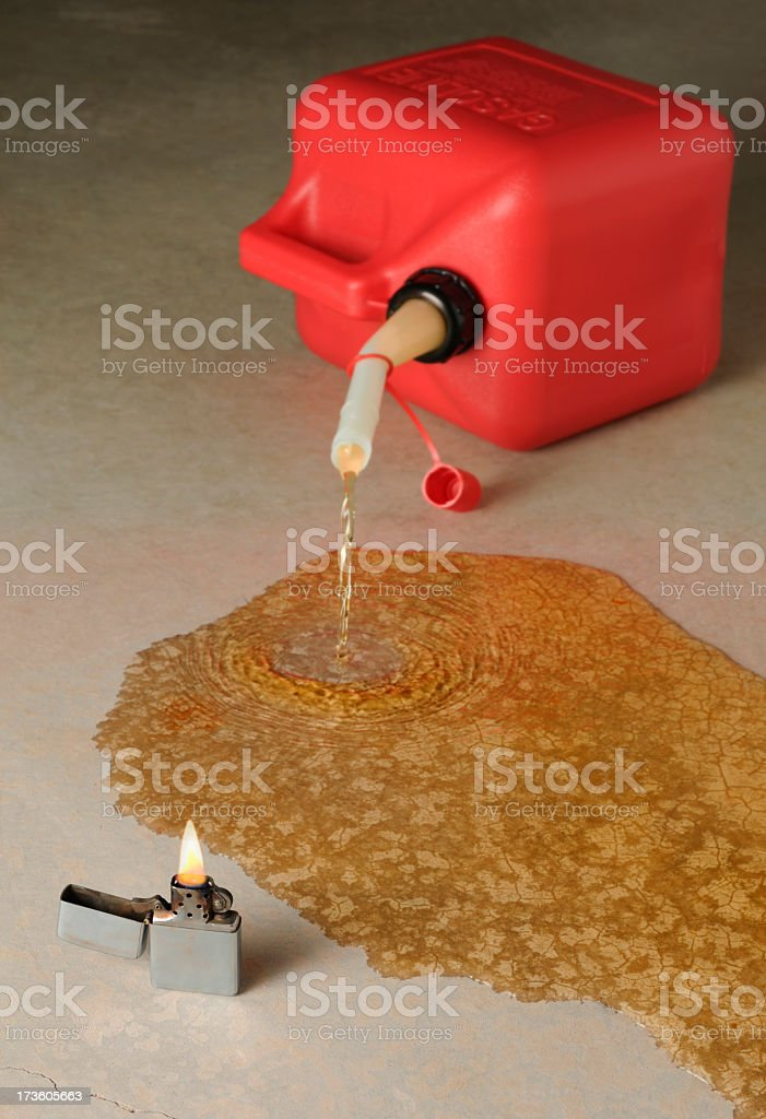 Tipped Gasoline Can Near Burning Lighter royalty-free stock photo