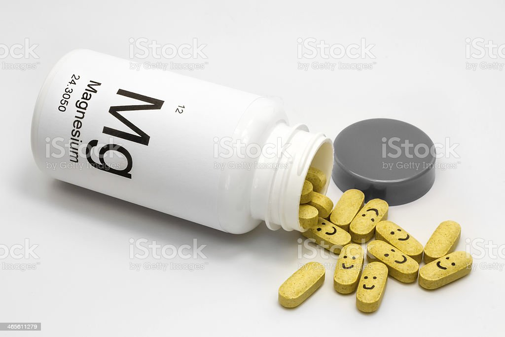 Tipped over bottle of Magnesium vitamins stock photo