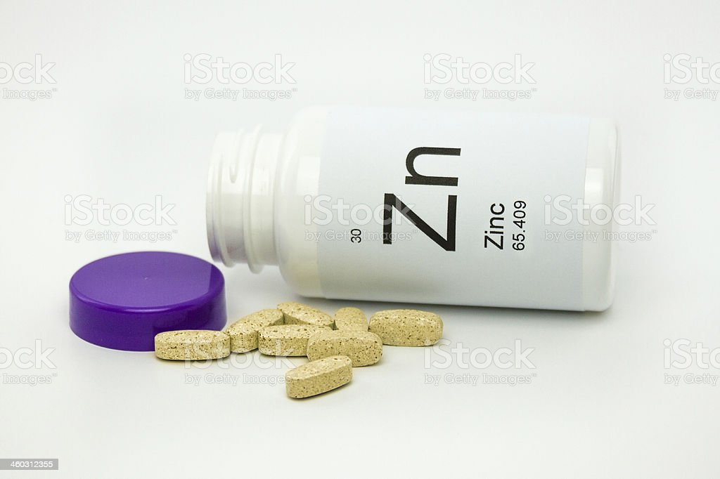 Tipped over bottle of Zinc vitamins royalty-free stock photo