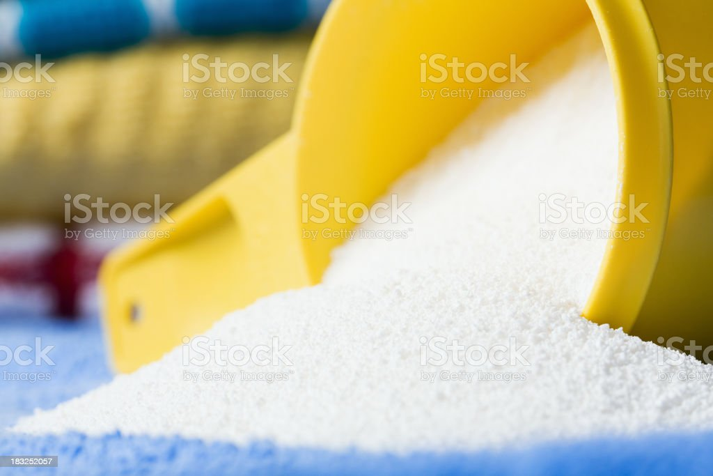 Tipped Over Measuring Cup of Laundry Detergent stock photo
