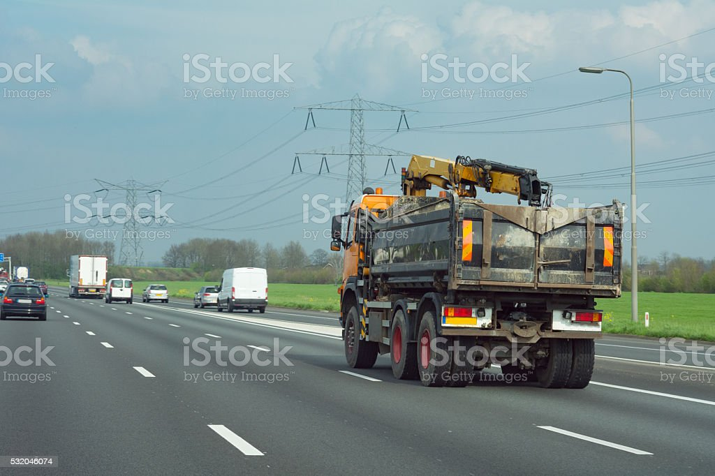 Tipper on  four lane highway stock photo