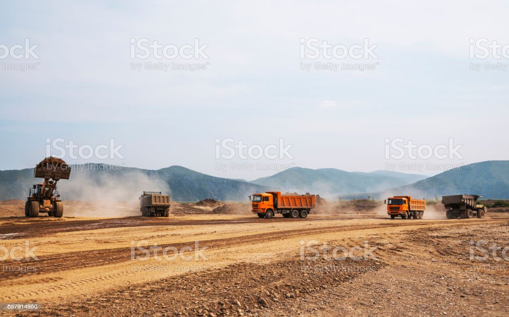 Tipper trucks and Loaders in operation (Earthworks ) stock photo