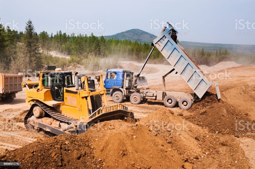 Tippers in operation, unloading of soil stock photo