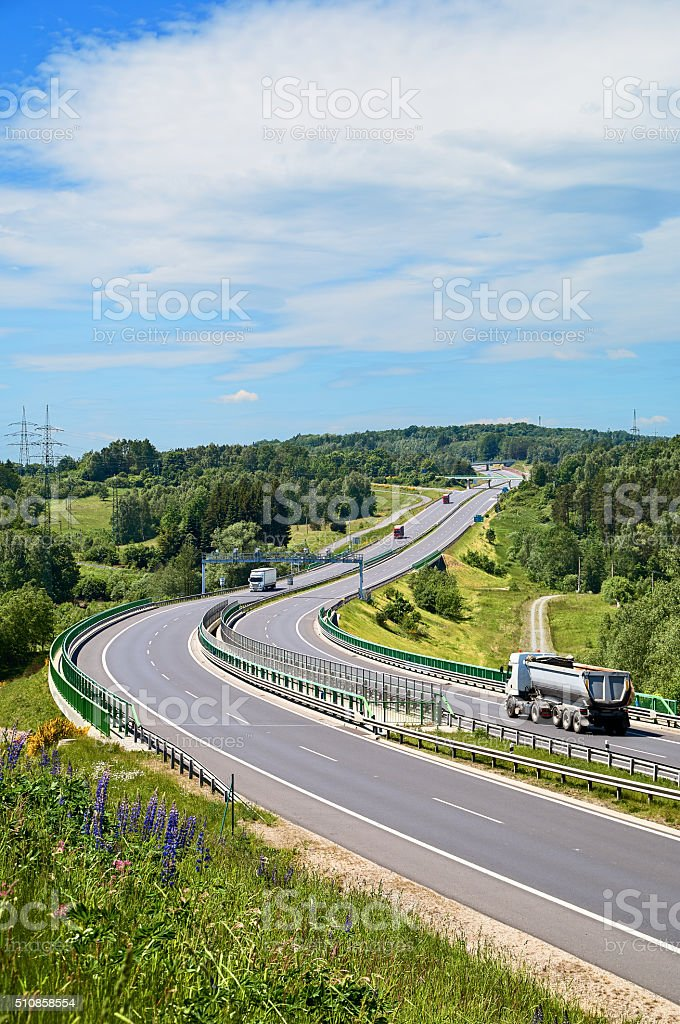 Tipping lory and trucks traveling on the highway stock photo