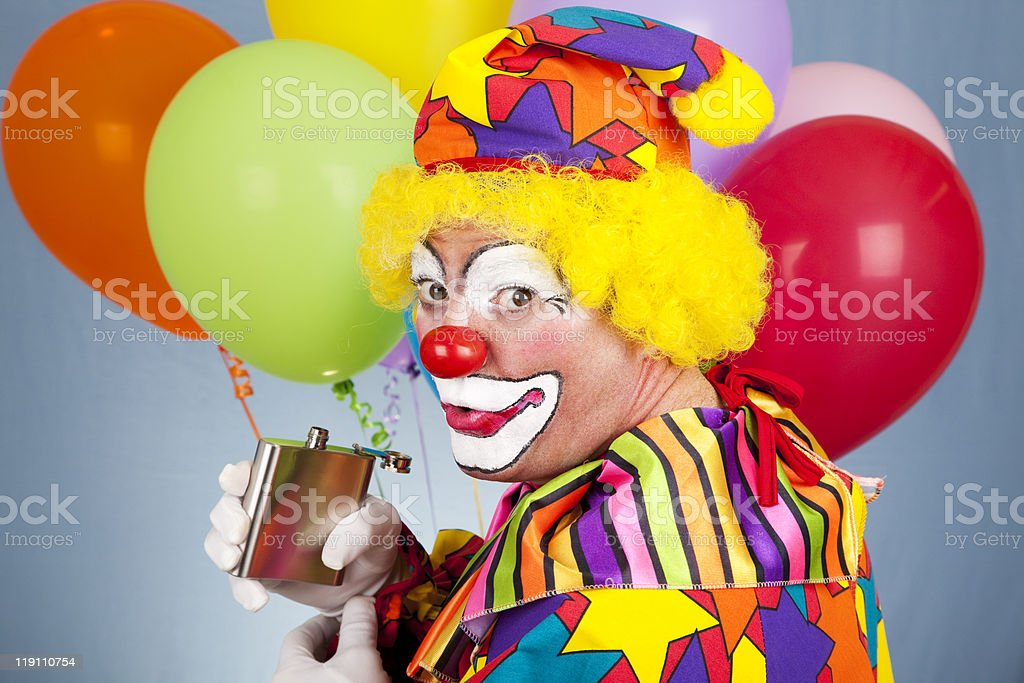 Tipsy Clown Sneaks a Drink royalty-free stock photo