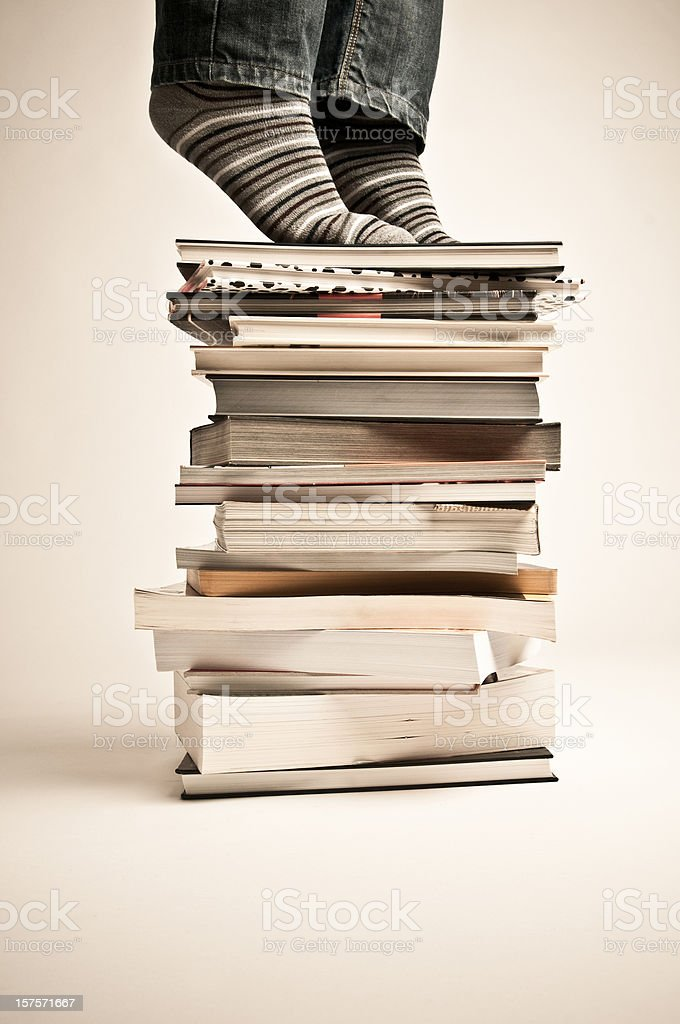 Tiptoed Librarian over pile of books royalty-free stock photo