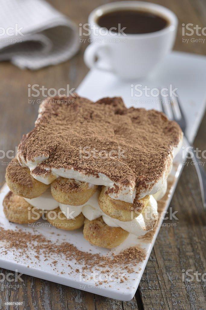 Tiramisu and coffee on a rustic table stock photo