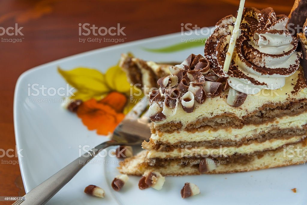 Tiramisu Cake And Fork On A Saucer stock photo