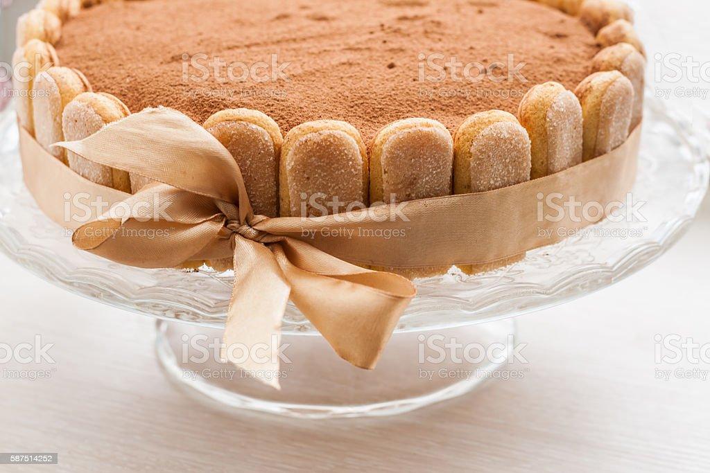 Tiramisu cake celebratory circular tied with a ribbon with bow stock photo