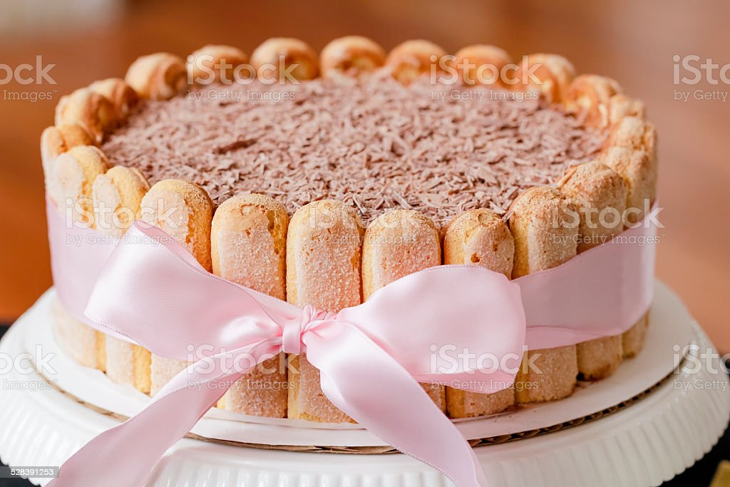 Tiramisu cake decorated with pink bow ribbon stock photo