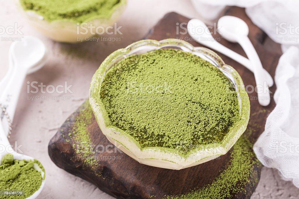 Tiramisu cake with green matcha tea stock photo