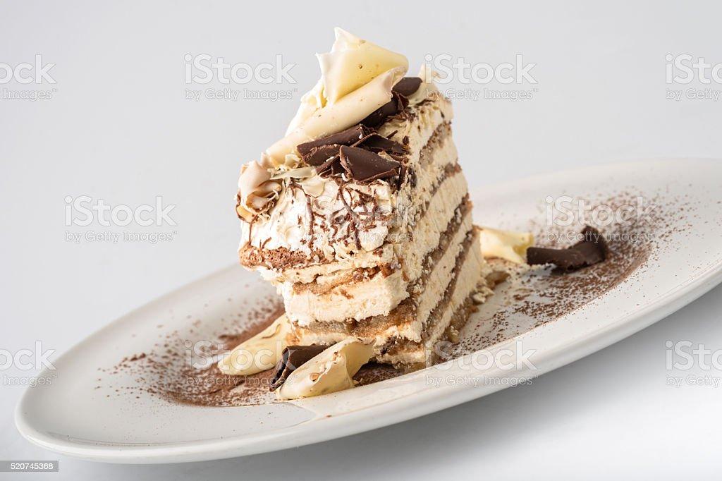 Tiramisu cake with white and dark chocolate flakes stock photo