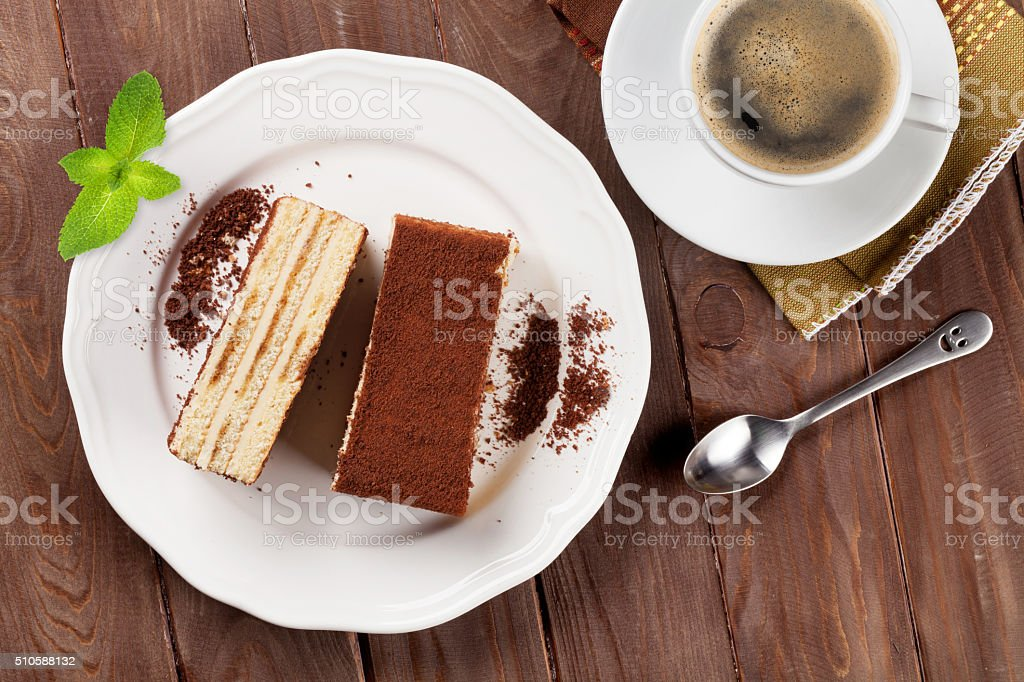 Tiramisu dessert and coffee on wooden table stock photo