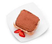 Tiramisu with strawberry on plate isolated. Top view.