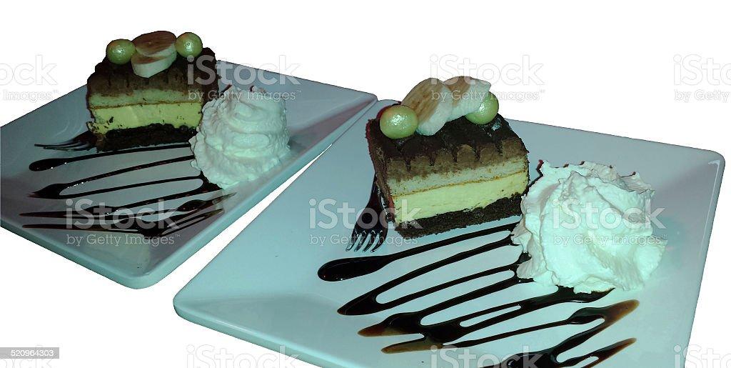 Tiramisu with whipped cream, isolated stock photo