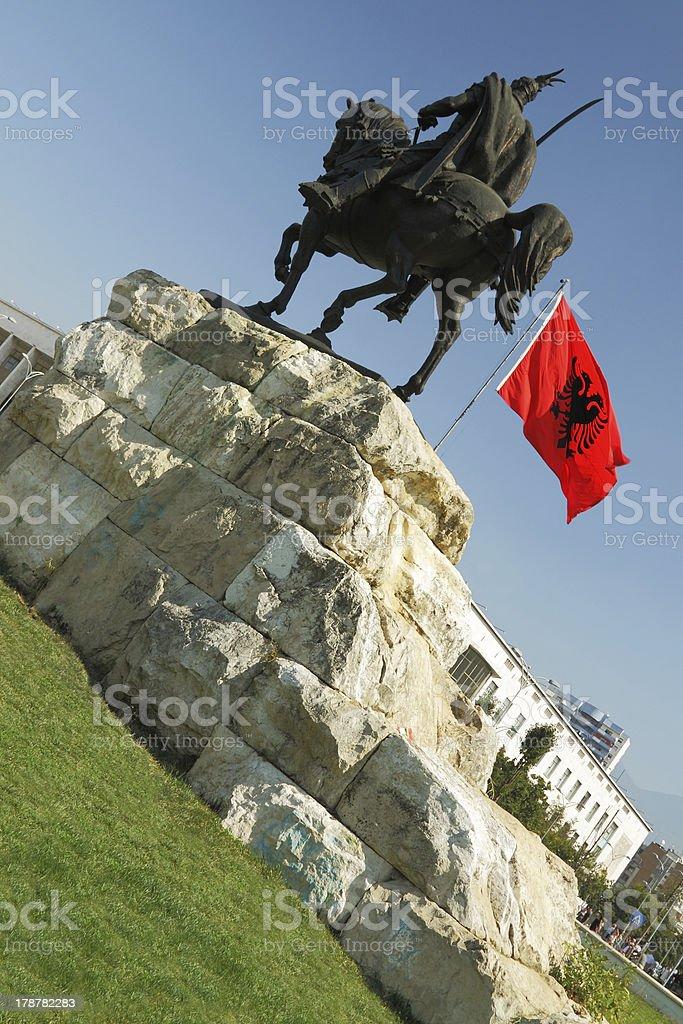 Tirana, Albania, Skanderbeg Monument and National Flag royalty-free stock photo