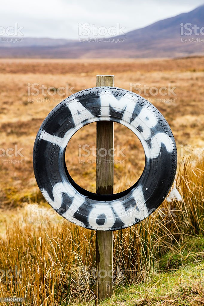 Tire alerting drivers that there are sheep on the road. stock photo