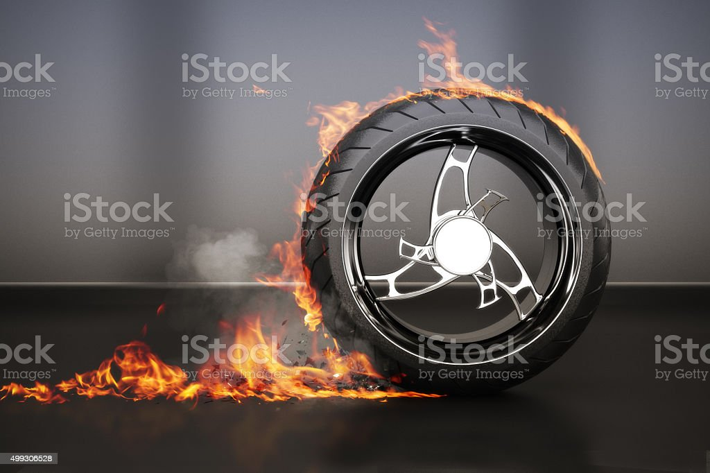 Tire burnout with flames smoke and debris,concept stock photo