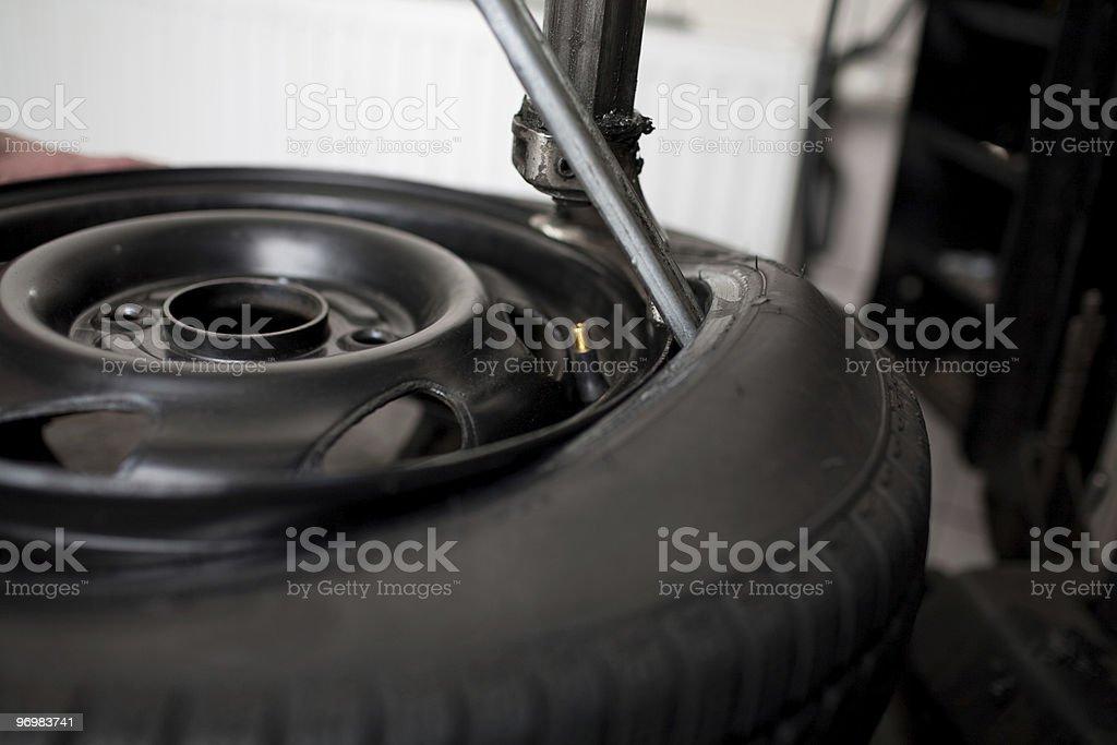 Tire change closeup stock photo