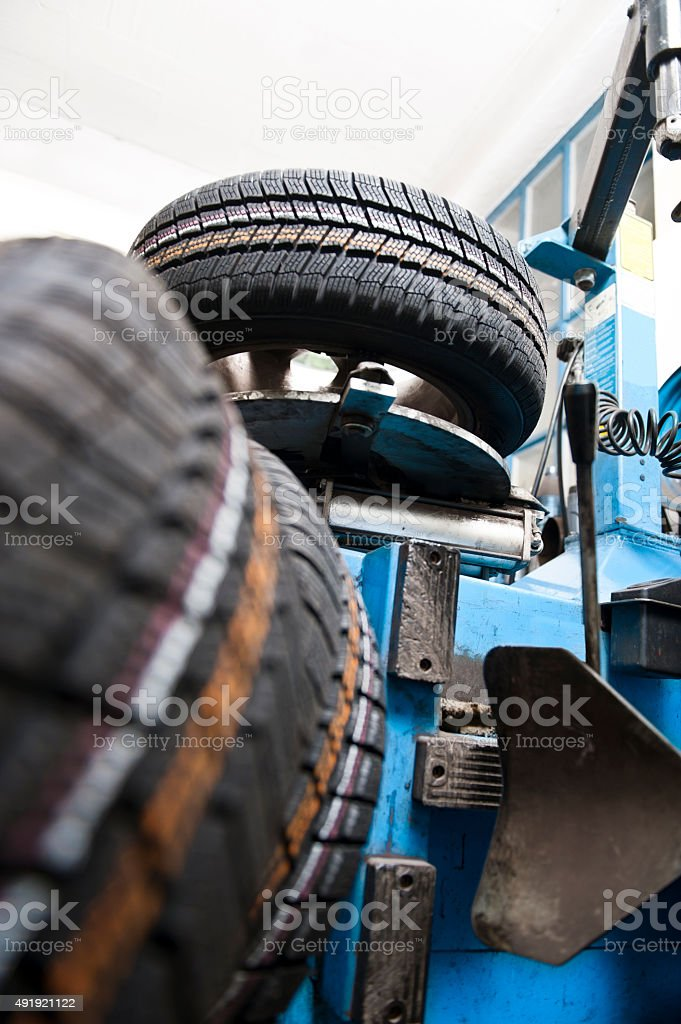 Tire changing stock photo
