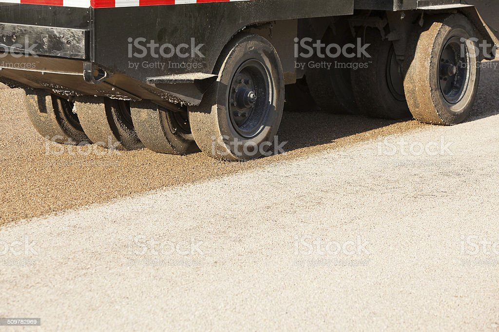 Tire Compactor Pressing Chip Seal into Asphalt stock photo