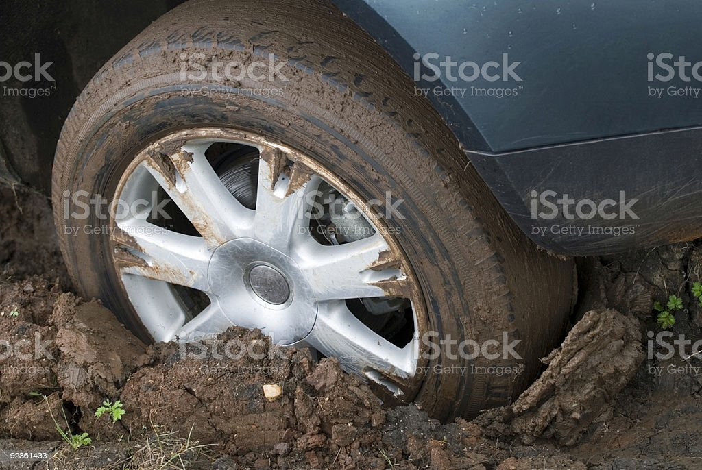 Tire in mud royalty-free stock photo