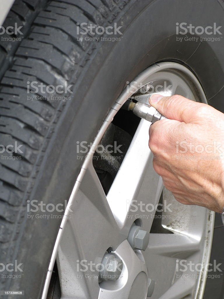 Tire Inflating Hand Close up Air Pressure stock photo