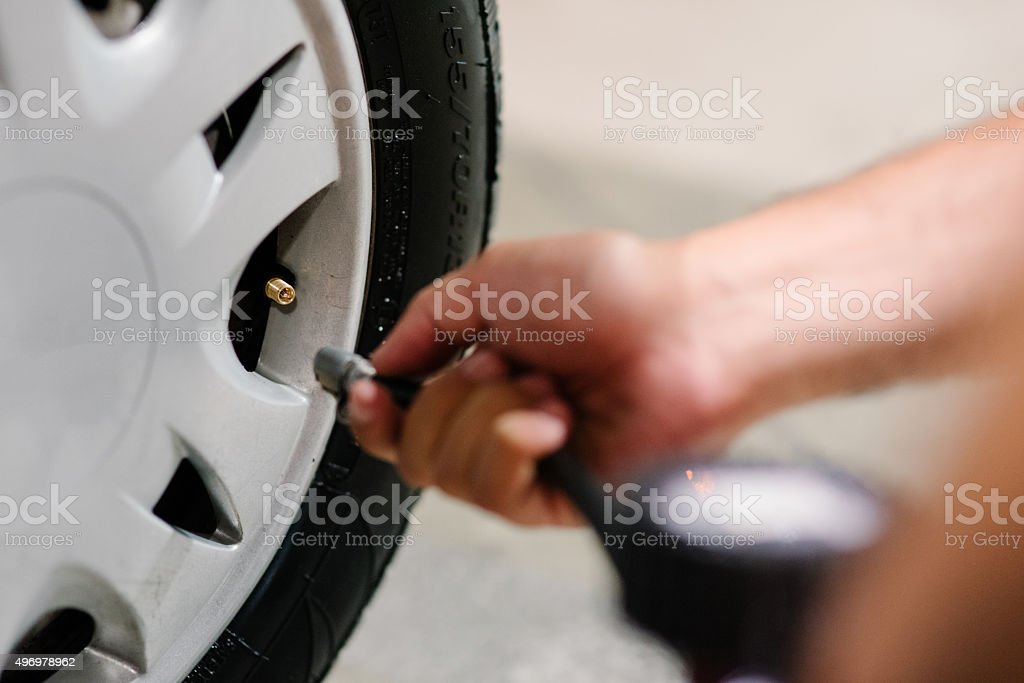 Tire inflating stock photo