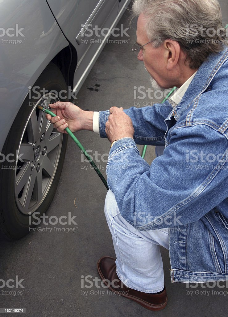 Tire maintenance royalty-free stock photo