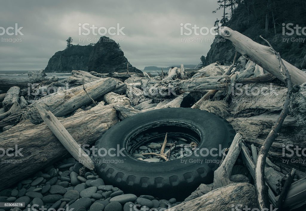 Tire on a Pacific Beach stock photo