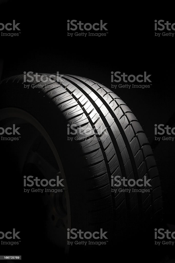 Tire on black background royalty-free stock photo