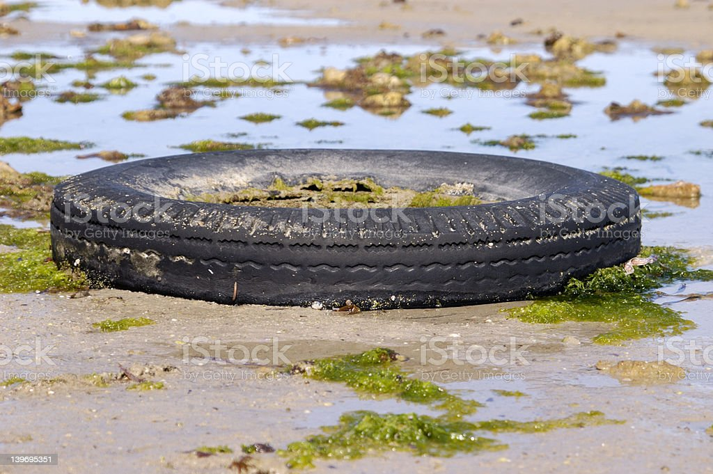 Tire on the Beach royalty-free stock photo