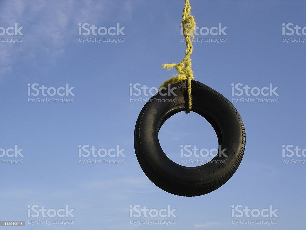 Tire Swing Against Blue Sky royalty-free stock photo