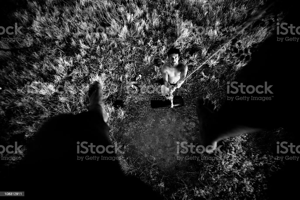 Tire swing from above - feet in foreground royalty-free stock photo