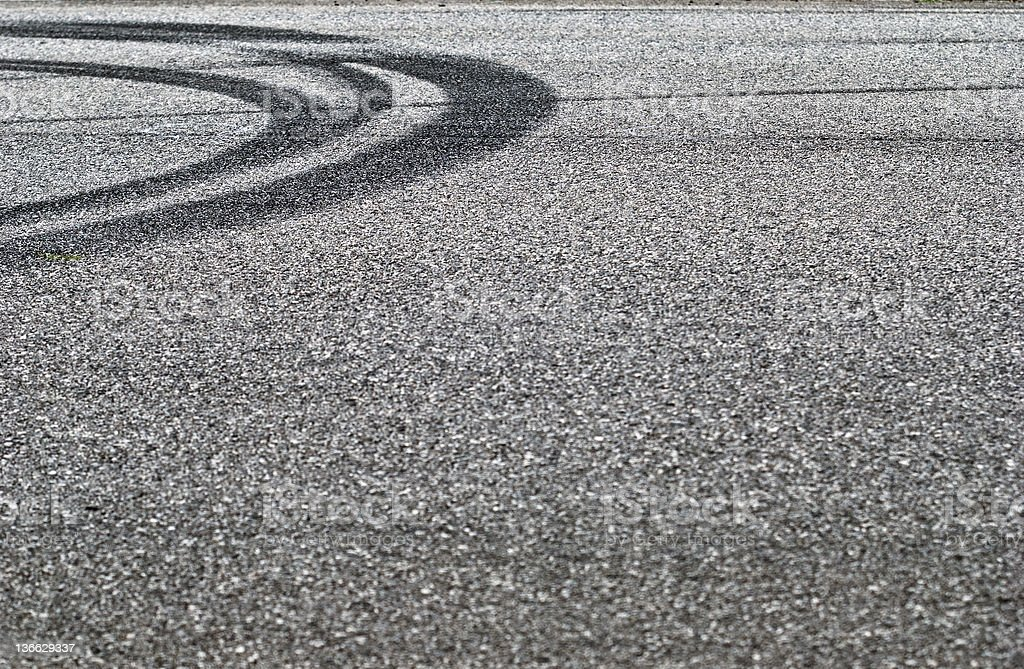 Tire track on asphalt stock photo